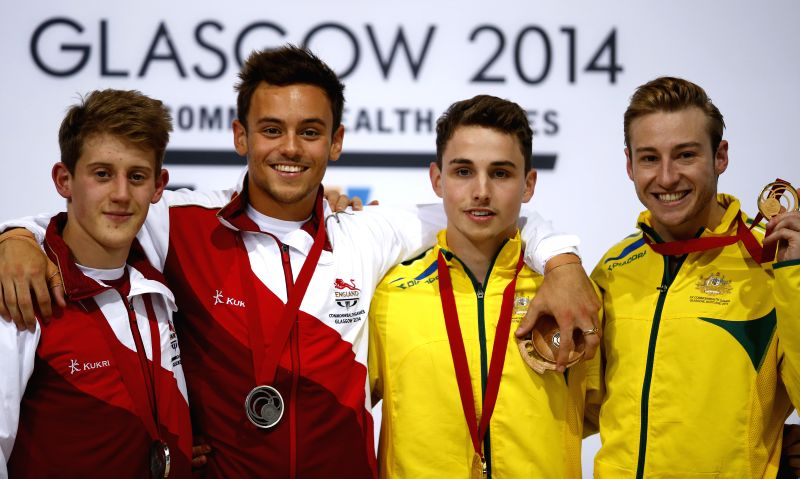 Silver medalists Tom Daley(2nd, L) and James Denny(1st, L) of England and gold medalists Mathew Mitcham(1st, R) and Dominic Bedggood of Australia pose on the ...