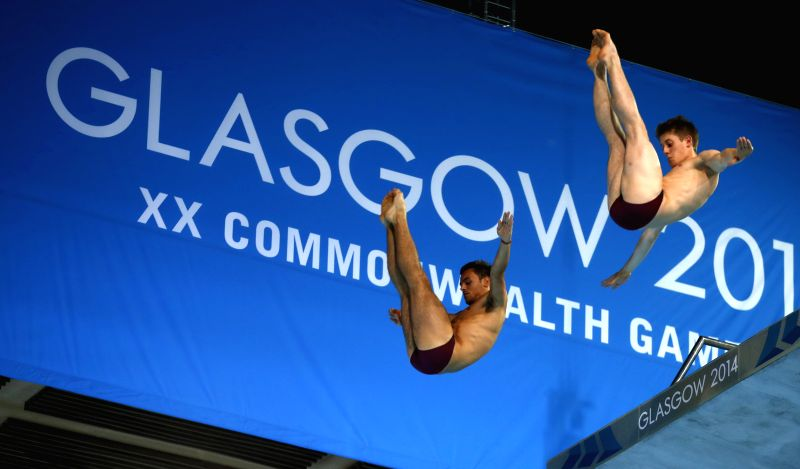 Tom Daley (L) and James Denny of England compete during the final for the Men's Synchronised 10M Platform of diving on day 9 of the Glasgow 2014 Commonwealth Games