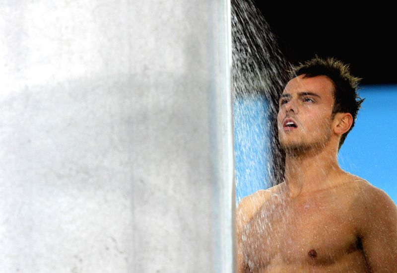 Tom Daley of England takes a shower during the Men's Synchronised 10M Platform Final of diving on day 9 of the Glasgow 2014 Commonwealth Games at Royal ...