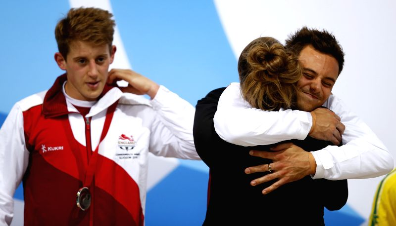 Tom Daley (R) of England reacts during the medal ceremony for the Men's Synchronised 10M Platform of diving on day 9 of the Glasgow 2014 Commonwealth Games at ...