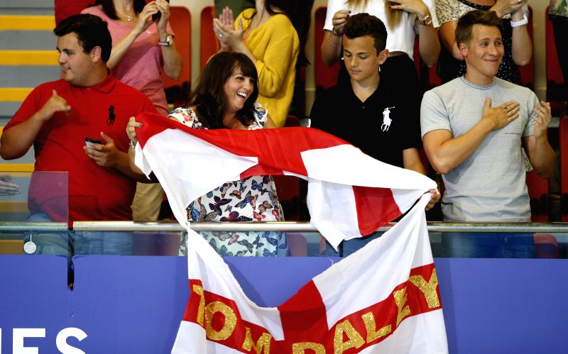 Tom Daley's brothers William(1st, L), Ben(2nd, R), mother Debbie(2nd, L) and Oscar winning screenwriter Dustin Lance Black cheer for him during the Men's ...