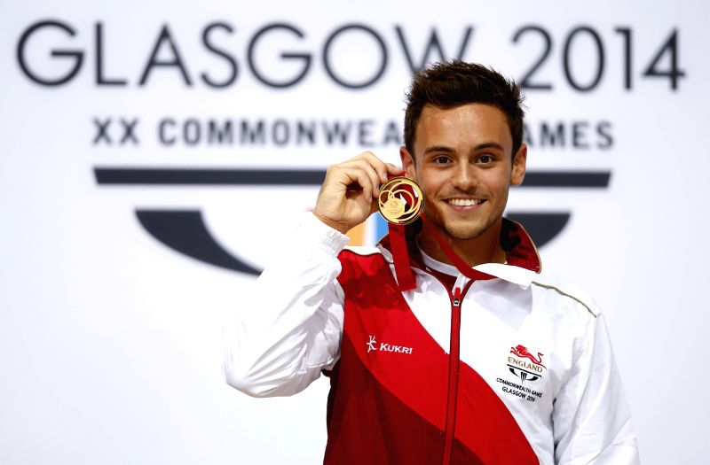 Tom Daley of England celebrates during the medal ceremony for the Men's 10M Platform Final of diving on day 10 of the Glasgow 2014 Commonwealth Games at Royal ...