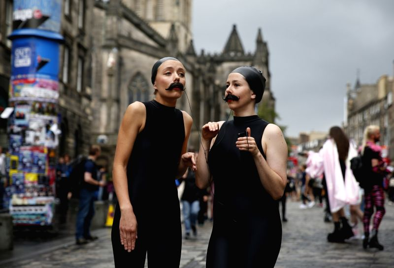 "EDINBURGH, Aug. 3, 2018 - Actresses of surreal comedy sea lion play ""Lucille and Cecilia"" perform on a street in Edinburgh, Scotland of Britain, Aug. 2, 2018. The Edinburgh Festival Fringe ..."