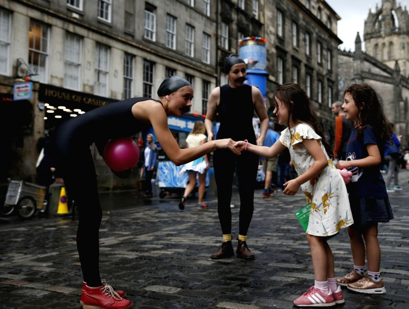 "EDINBURGH, Aug. 3, 2018 - Actresses of surreal comedy sea lion play ""Lucille and Cecilia"" interact with children on a street in Edinburgh, Scotland of Britain, Aug. 2, 2018. The Edinburgh ..."