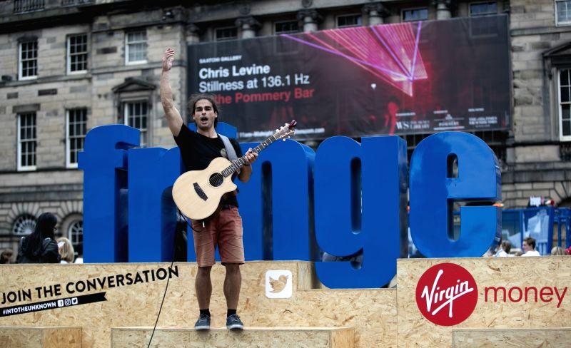 EDINBURGH, Aug. 4, 2018 - An Australian plays guitar on the opening day of the Edinburgh Festival Fringe 2018 in Edinburgh, Scotland, Britain on Aug. 3, 2018.