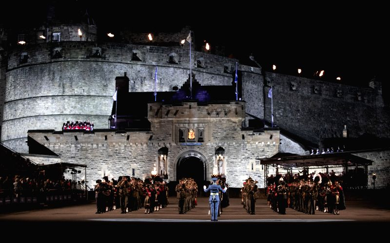 EDINBURGH, Aug. 5, 2018 - Military performers are on stage in front of the Edinburgh Castle during the Royal Edinburgh Military Tattoo 2018 in Edinburgh, Scotland, Britain, on Aug. 4, 2018.