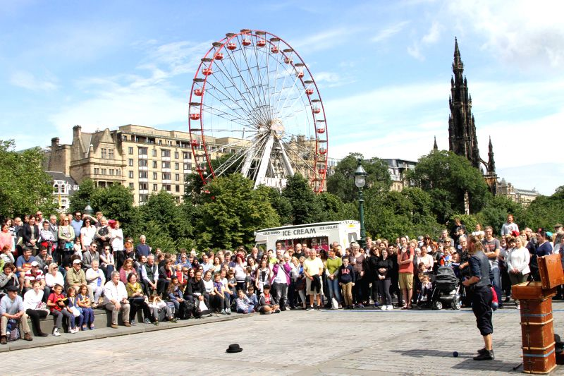 EDINBURGH (BRITAIN), Aug. 6, 2016 People watch a street show on the opening day of the Edinburgh Festival Fringe (The Fringe) in Edinburgh, Britain, on Aug. 5, 2016. Three important ...