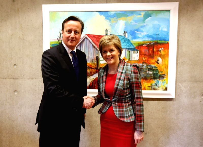 British Prime Minister David Cameron (L) shakes hands with Scottish First Minister Nicola Sturgeon at the Holyrood Scottish parliament in Edinburgh, Britain, Jan. - David Cameron