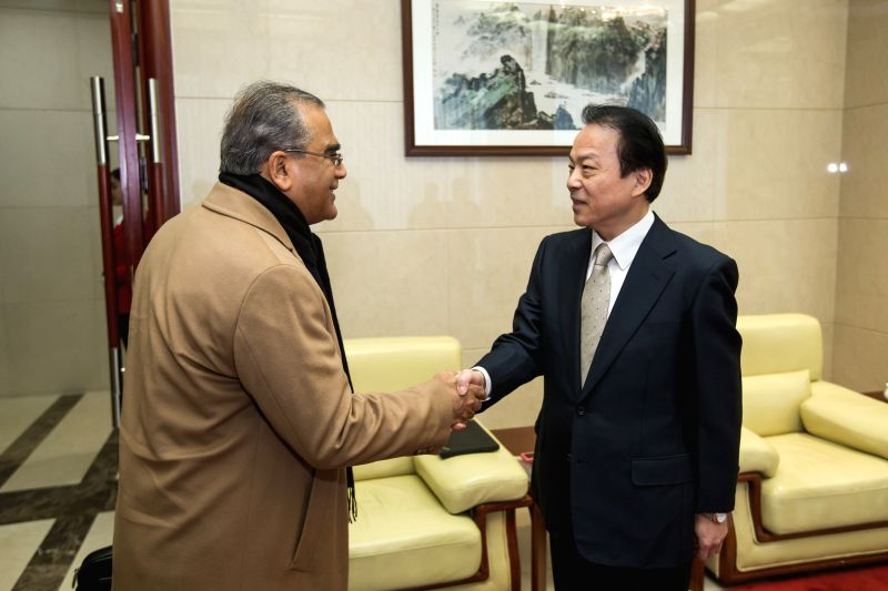 Editor-in-Chief of Xinhua News Agency He Ping (R) meets with his India Today Group counterpart Aroon Purie in Beijing, capital of China, Nov. 30, 2015. (Xinhua/Shen ...