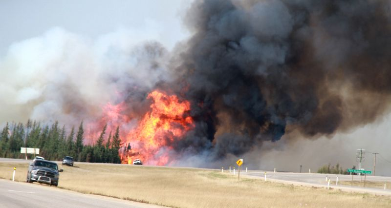 EDMONTON, May 8, 2016 - Flames rise off in Alberta Province of Canada, May 7, 2016. The massive wildfire in Alberta Province has covered more than 2,000 square kilometers by Saturday and forced ...