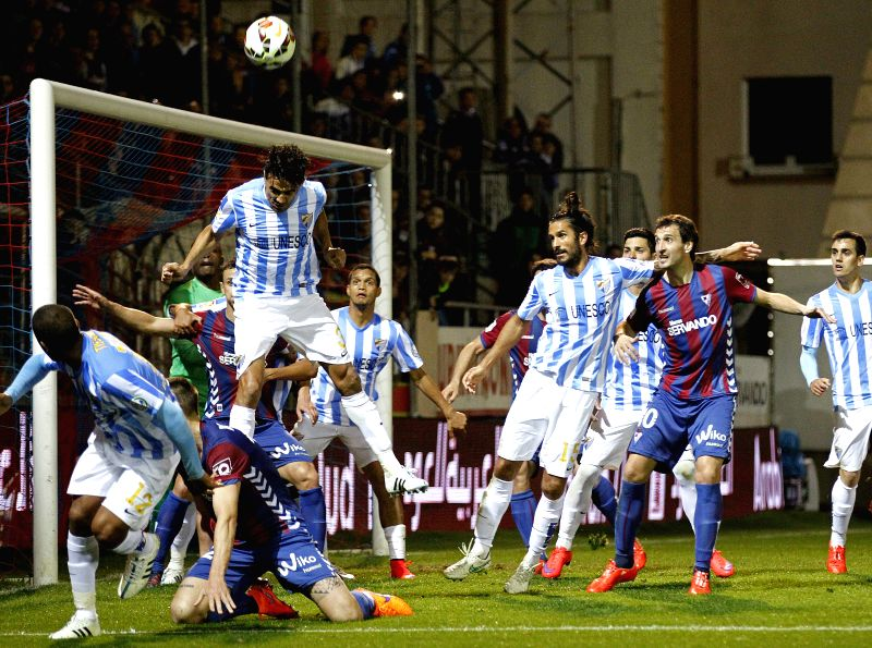Eibar and Malaga players vie for the ball during the Primera Division liga match held at the Ipurua stadium in Eibar, Spain, 08 April 2015.