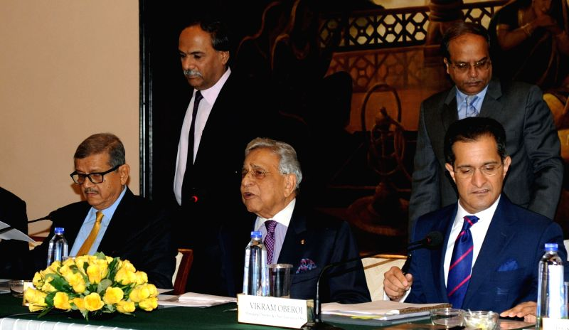 EIH Limited Executive Chairman PRS Oberoi (C) Executive Vice Chairman SS Mukherji (L) and Managing Director and Chief Executive Officer Vikram Oberoi (R) during company's AGM in Kolkata on ...