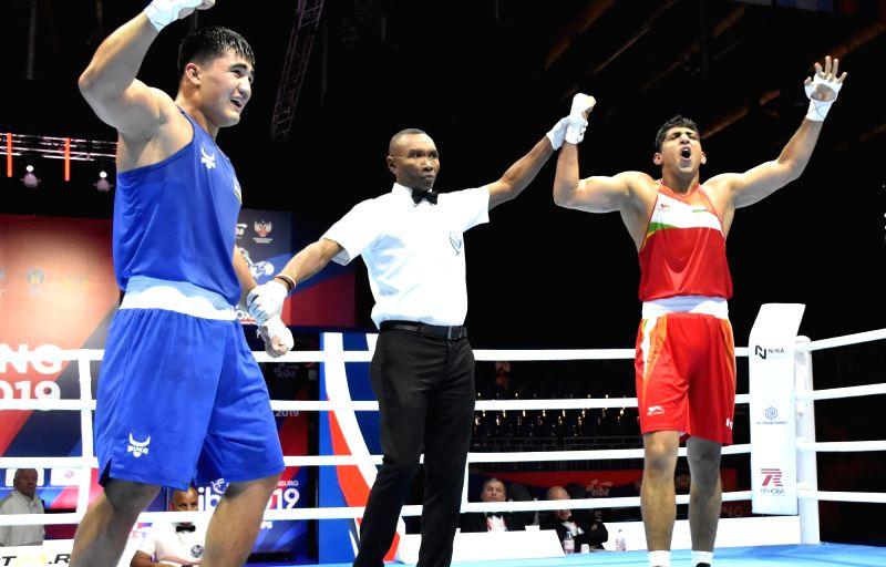 Ekaterinburg: India's Sanjeet celebrates after defeating Uzbekistan's Sanjar Tursunov during the AIBA Men's World Championships in Ekaterinburg, Russia on Sep 17, 2019. (Photo: IANS)