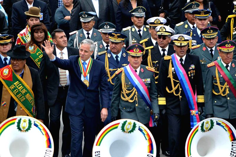 Bolivia's Vice President Alvaro Garcia Linera (2nd L, front) leads the official acts for the 30th anniversary of the founding of El Alto city, in El Alto city, ...