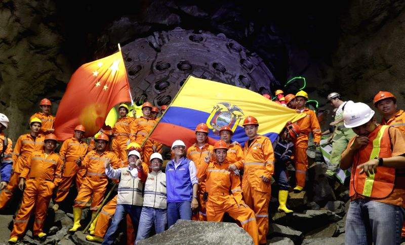 The Ecuadoran Vice President, Jorge David Glas (C), poses with employees in one of the tunnels of the Coca Codo Sinclair hydroelectric project, in El Chaco, Napo ...