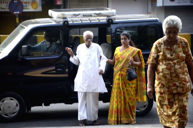 Elderly people arrive to cast their votes during the sixth phase of 2014 Lok Sabha Polls  in Mumbai on April 24, 2014.