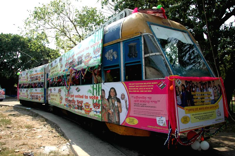 Election commission uses a tram to diffuse voters' awareness messages in Kolkata on May 2, 2014.