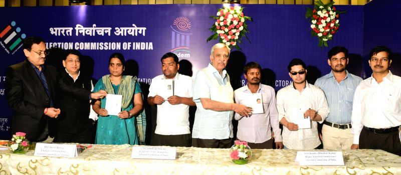 Election Commissioner Sunil Arora and Deputy Election Commissioner Umesh Sinha distributes the Braille EPIC CARDS for visually impaired, at a function,in Bengaluru, on July 19, 2018. - Commissioner Sunil Arora