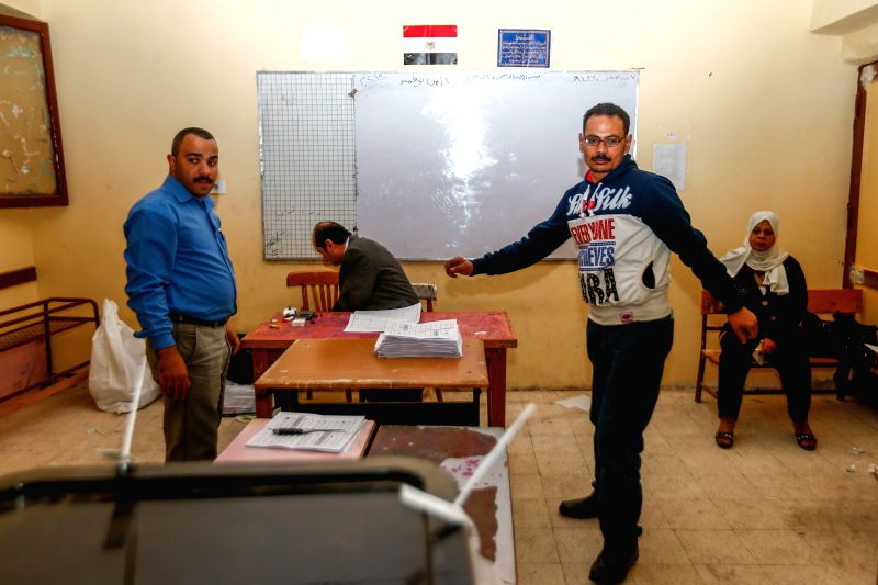 Election committee staff members start to count ballots after the polling station closes down in Cairo, Egypt, Nov. 23, 2015. The second phase of Egypt's ...