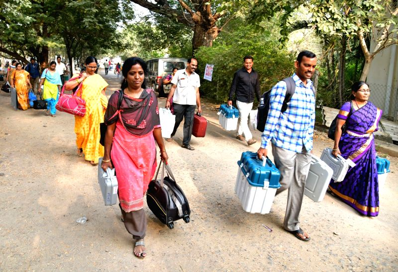 Election officials leave for their respective polling stations on the eve of Telangana Assembly elections in Hyderabad on Dec 6, 2018.