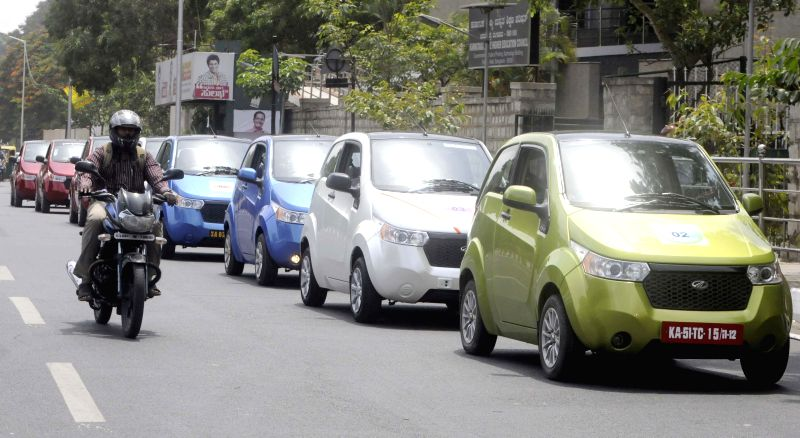 Electric Cars rally, during awareness campaign by Mahindra to create consciousness about environmental degeneration and the need for alternative mode of transport, in Bangalore on June 28, 2014.