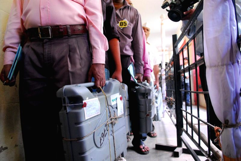 Electronic Voting Machines (EVMs) being taken for counting at a counting centre in Mumbai on May 16, 2014.