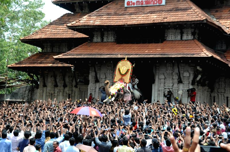 "Elephant ""Thechikottukavu Ramachandran"" opens the door of the southern gopuram of the Vadakkumnathan temple to formally announce the beginning of the Thrissur Pooram in Kerala's ..."