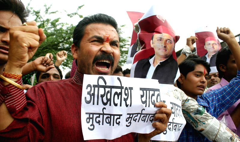 embers of Sanskriti Bachao Manch demonstrate against Uttar Pradesh Chief Minister Akhilesh Yadav to protest against alleged gangrape and forced conversion of a woman in Meerut, Uttar Pradesh; in ... - Akhilesh Yadav