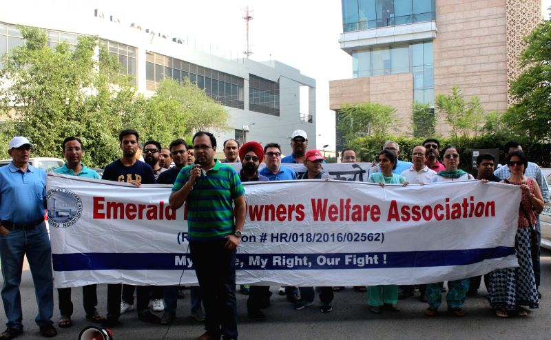 Emerald Hills Owners Welfare Association members stage a demonstration against the EMAAR MGF builder outside its office in Gurgaon on May 6, 2017.