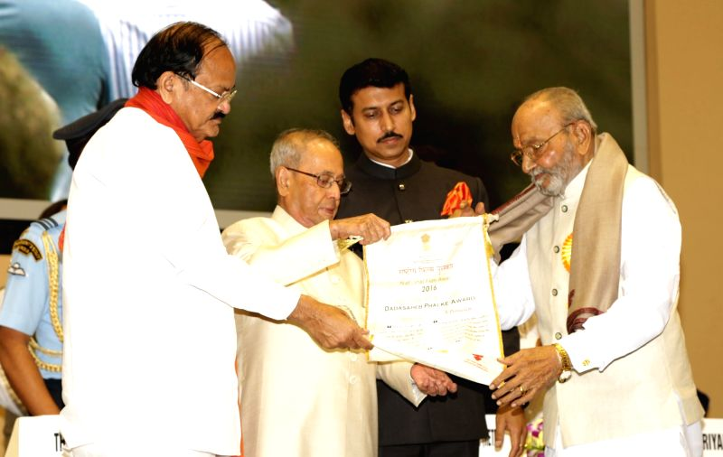 Eminent film director and actor K. Viswanath who was named for the coveted Dadasaheb Phalke Award being felicitated by President Pranab Mukherjee at the 64th National Film Awards Function, ... - K. Viswanath, M. Venkaiah Naidu, Pranab Mukherjee and Rajyavardhan Singh Rathore