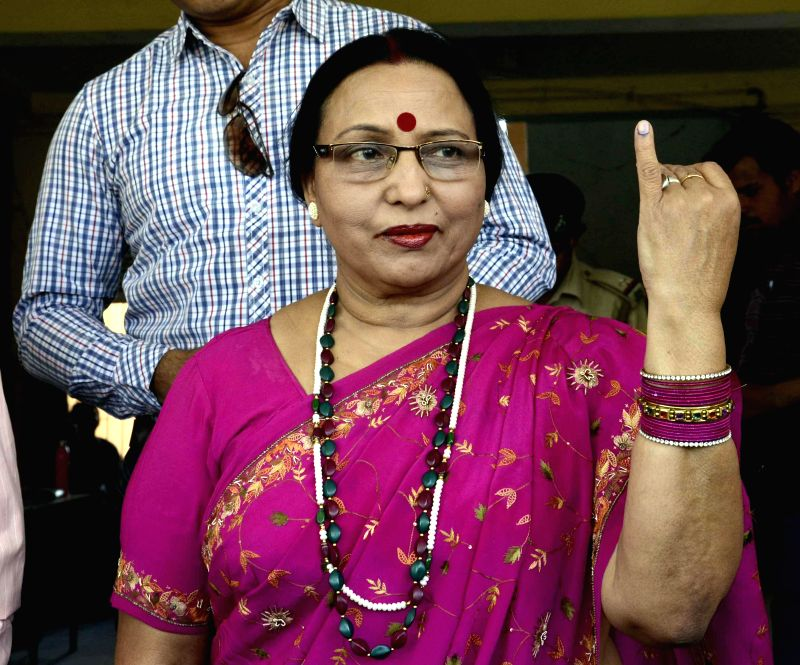 Eminent folk singer and Padma Shri awardee Sharda Sinha shows her fore finger marked with phosphoric ink after casting her vote during the fifth phase of 2014 Lok Sabha Polls in Patna on April 17, ...