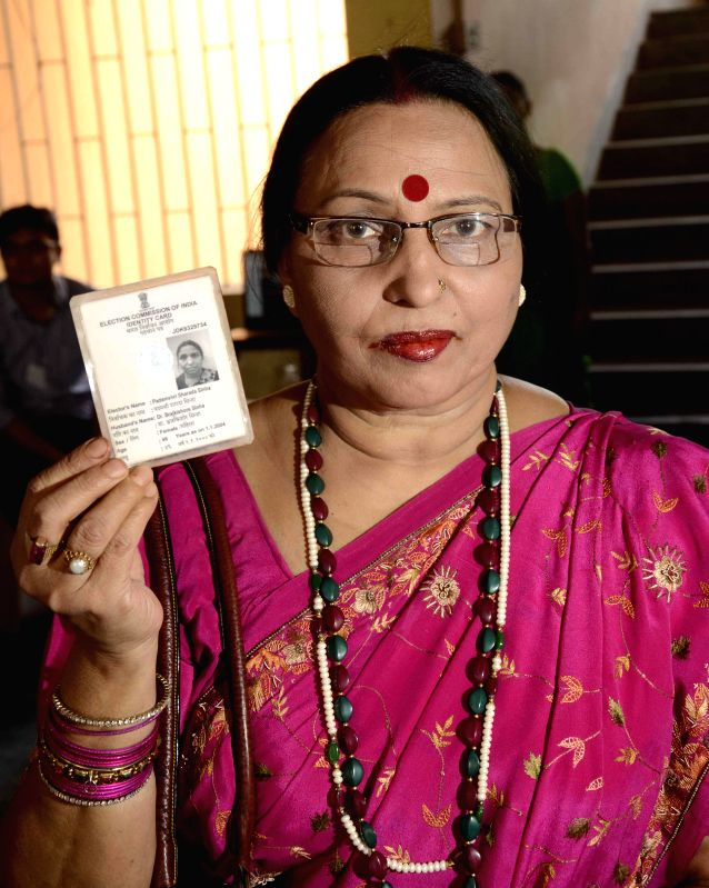 Eminent folk singer and Padma Shri awardee Sharda Sinha shows her voters' identity card after casting her vote during the fifth phase of 2014 Lok Sabha Polls in Patna on April 17, 2014.