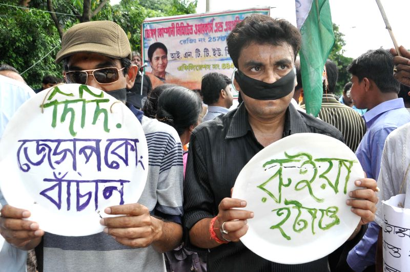 Employees of Jessop & Company Ltd participate in a silent rally to urge West Bengal Chief Minister Mamata Banerjee to re-open their factory in Kolkata on August 1, 2014. - Mamata Banerjee
