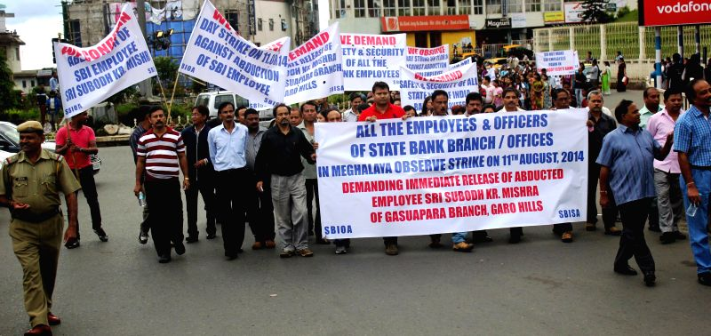 Employees of State Bank of India take out a rally to demand immediate release of their colleague Subodh Kumar Mishra, who was abducted by militants last Tuesday (5th August, 2014) in Shillong, on Aug - Subodh Kumar Mishra