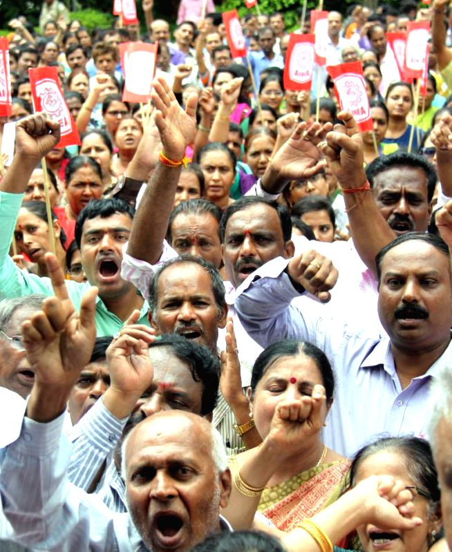 Employees of State Bank of Mysore stage a demonstration to press for their demands in Bengaluru, on May 20, 2016.