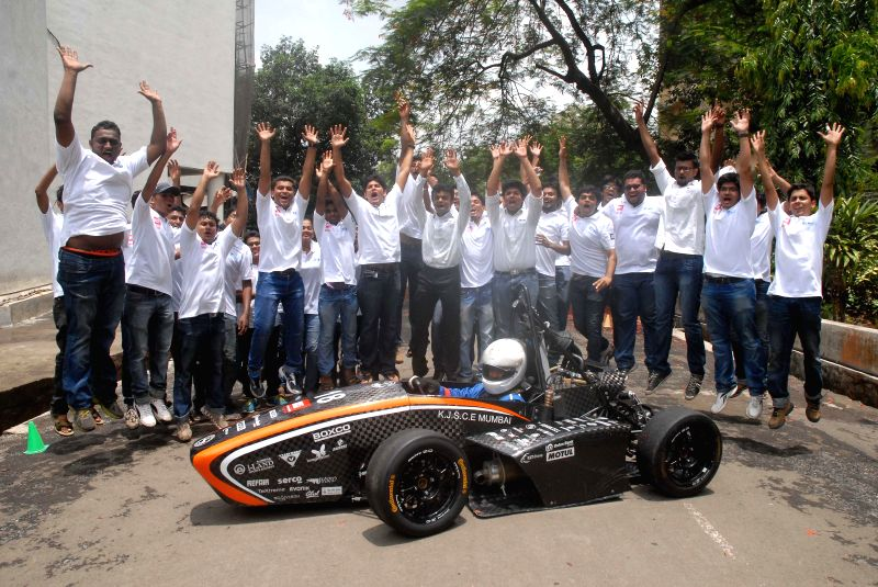 Engineering students with ORI - 2014 - a race car in Mumbai on July 4, 2014.