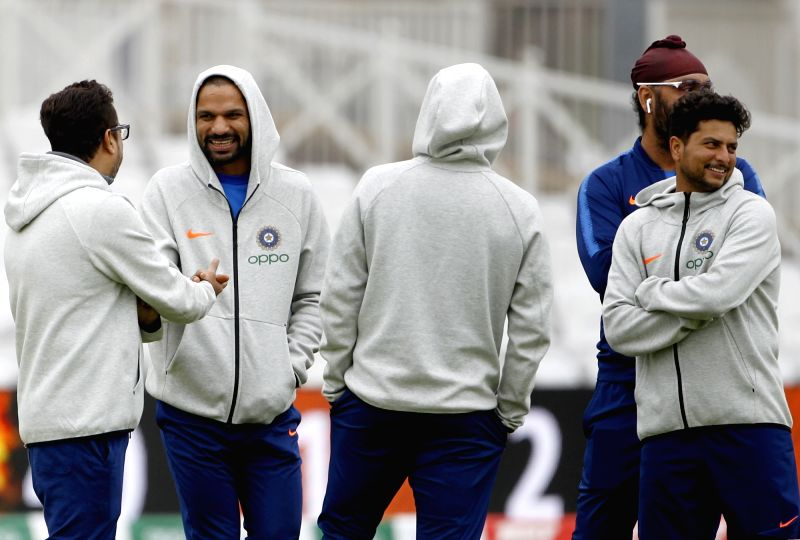 England: National selector Sarandeep Singh with Indian cricketers Shikhar Dhawan and Kuldeep Yadav during a practice session ahead of the 2019 World Cup match against New Zealand, at Trent Bridge Cricket Ground in Nottinghamshire, England on June 12,