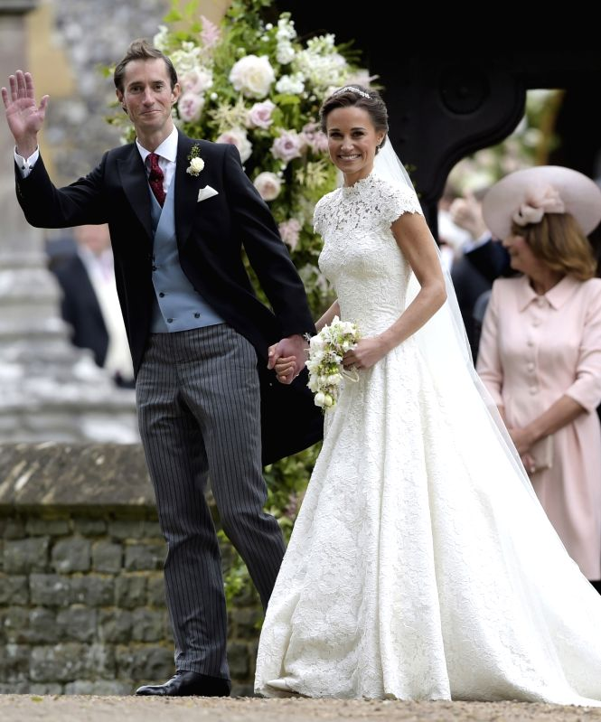 ENGLEFIELD (BRITAIN), May 20, 2017 Pippa Middleton (R) and James Matthews smile after their wedding at St. Mark's Church in Englefield, Britain on May 20, 2017. Pippa Middleton, the ...