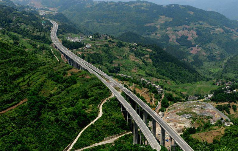 Photo taken on June 1, 2014 shows a segment of the Shanghai-Chengdu Expressway in Badong County of Enshi, central China's Hubei Province. The 1,966-kilometer ...