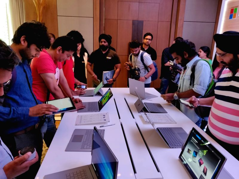 Enthusiasts at the launch of Microsoft Surface Book 2 series of laptops in New Delhi on Aug. 7, 2018.