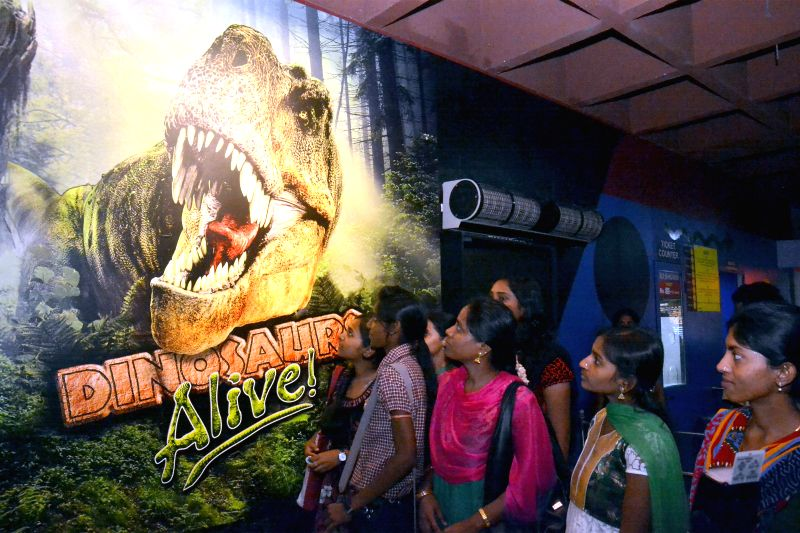 eople arrive at the launch of c at Visvesvaraya Industrial and Technological Museum in Bangalore on June 25, 2014.
