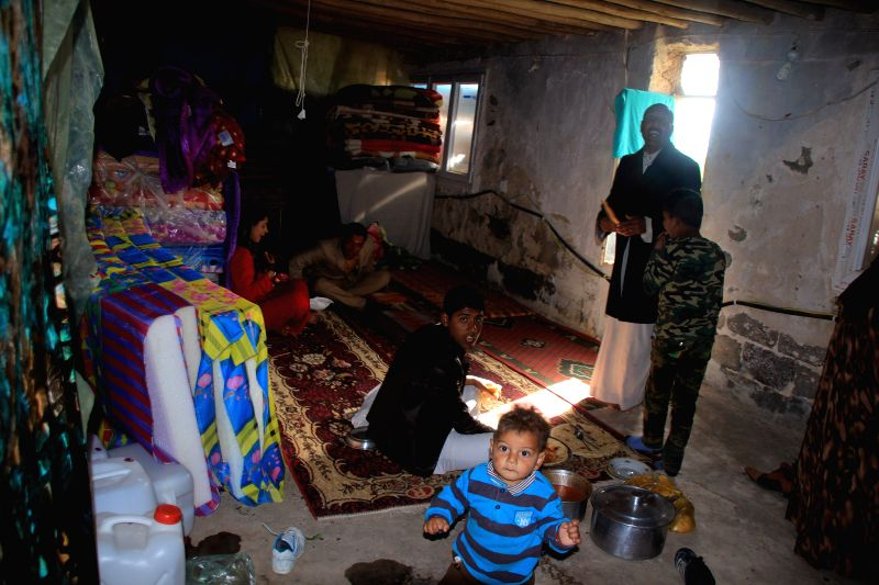 An Iraqi family lives in a makeshift house in Erbil, the capital city of Iraqi Kurdish region, on Feb. 7, 2015. Lots of Iraqi people fled out of northern Iraq's Mosul