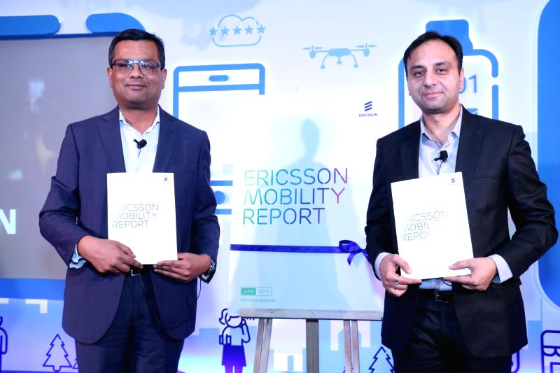 """Ericsson India Head of Network Products Nitin Bansal (L) and Head of Network Product Solutions Amit Bhardwaj (R) release """"Ericsson Mobility Report 2017"""" in New Delhi, on June 14, ..."""