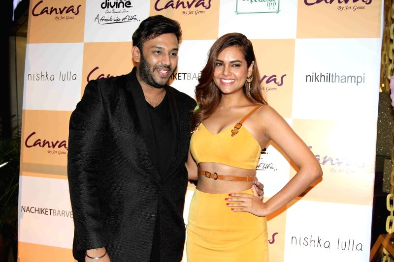 Esha Gupta and Nikhil Thampi during the launch of jewellery brand, Canvas by Jet Gems in Mumbai on Dec 3, 2015. - Esha Gupta