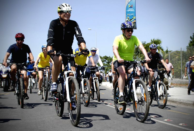 Ecuador's President Rafael Correa (L, front) and his Colombian counterpart Juan Manuel Santos (R, front) ride bicycles in the context of the 3rd Binational Cabinet in Esmeraldas city, ...