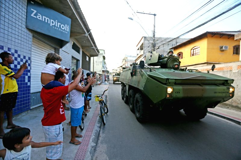ESPIRITO SANTO, Feb. 10, 2017 - People welcome armored vehicles arriving to tight security in Vitoria, the capital of southeastern state of Espirito Santo, Brazil, on Feb. 9, 2017. Brazil's armed ...