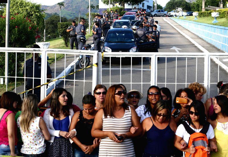 ESPIRITO SANTO, Feb. 12, 2017 - Family members of military policemen block the entrance of police headquarters in Vitoria, Espirito Santo state, Brazil, on Feb. 11, 2017. Military police officers in ...