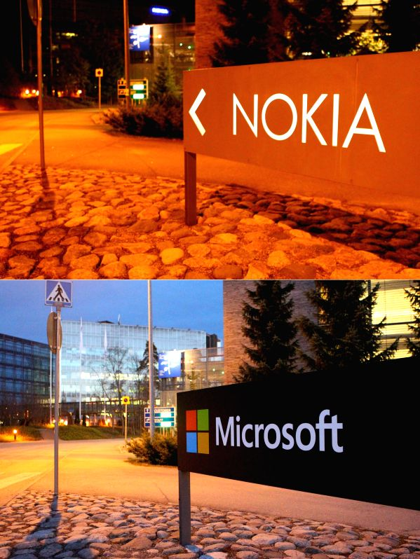 The combined photo shows that the logo of Nokia (top, taken on Sept. 8, 2013) installed in the former Nokia headquarters in Espoo, Finland, has been replaced by the