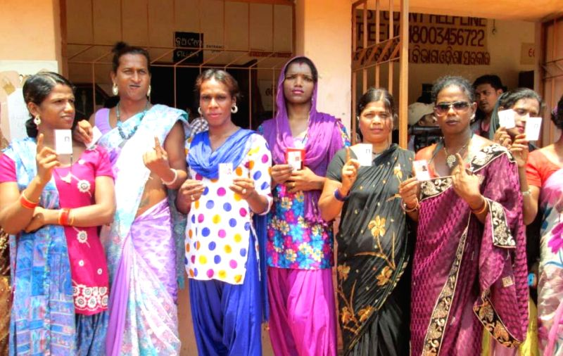 Eunuchs show their fore fingers marked with phosphoric ink after casting their votes during the fifth phase of 2014 Lok Sabha Polls in Bhubaneswar on April 17, 2014. (Photo : Arabinda Mahapatra/IANS)