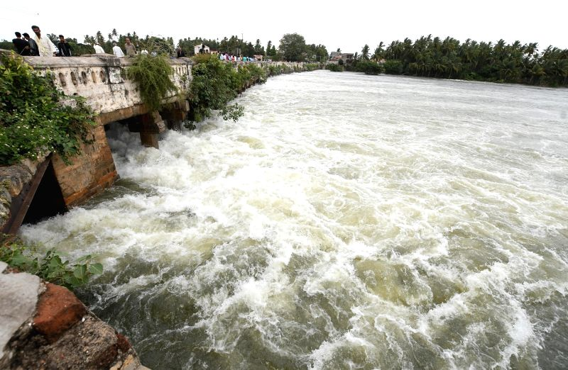 Excess water being released from the Krishna Raja Sagara (KRS) reservoir after heavy rains in the Cauvery catchment areas filled it to its maximum limit, in Mysuru on July 16, 2018.